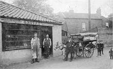 Jack Hall with pony cart outside G Moore bootmaker shop in Mundesley Road.