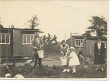 Land belonging to Aylsham House in the 1920's. Barbara Blewitt (now Thirwell) helps to feed the chickens.
