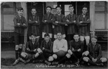 North Walsham 2nd XI football team outside Paston School Pavillion, Norwich Road.