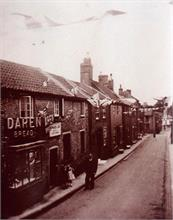 Vicarage Street, North Walsham, showing baker's shop