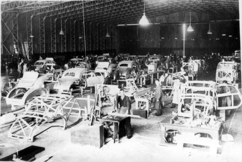 Photograph. Duncan Industries (Engineering) Ltd, Park Hall, New Road, North Walsham. Duncan Alvis assembly line at Swannington Airfield in autumn 1947 (North Walsham Archive).