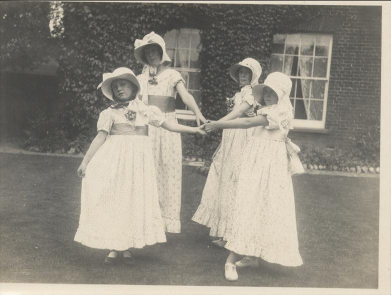 Photograph. Elizabeth and Barbara Blewitt dance with Nancy and Jean Hart (daughters of Dr. Hart) at Aylsham House in the 1920's. (North Walsham Archive).