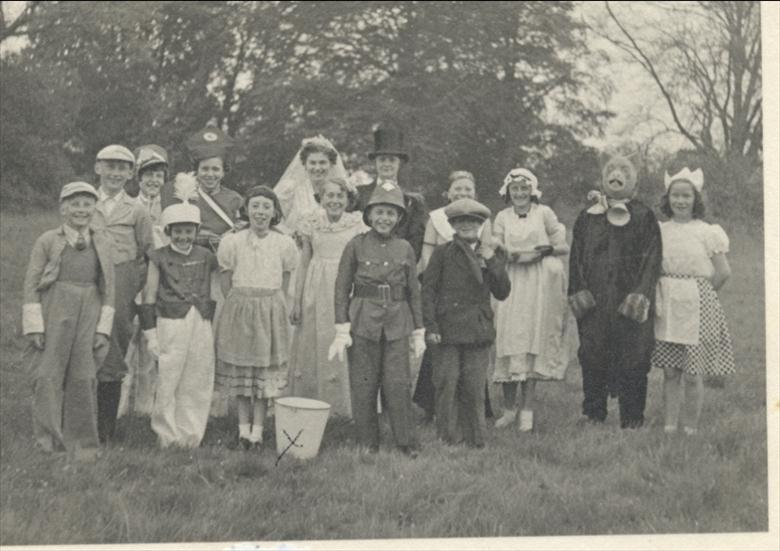 Photograph. Fancy Dress Parade at the end of the War. (North Walsham Archive).