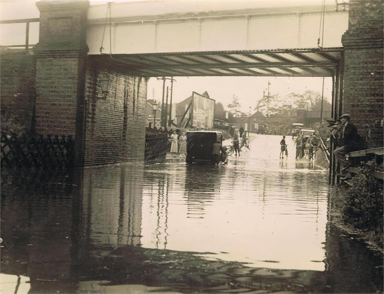 Photograph. Flood under Midland and Great Northern Joint Railway line bridge, Norwich Road. (North Walsham Archive).
