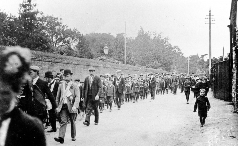 Photograph. Friendly Societies' parade along Yarmouth Road, North Walsham. (North Walsham Archive).