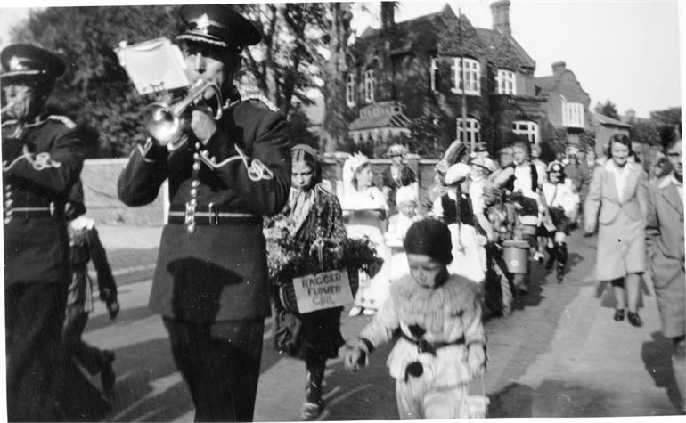Photograph. Grammar School Road Procession in the 1940s (North Walsham Archive).