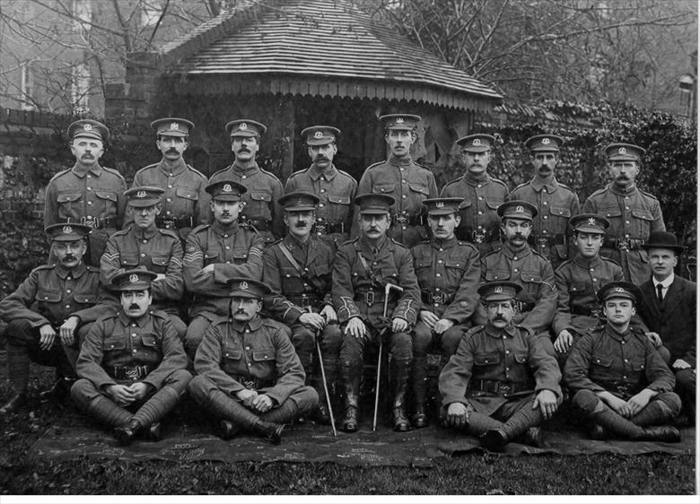 "Photograph. ""Home Guard"", 1918, Tudor House, Grammar School Road, North Walsham. Capt. John Dixon seated centre. (North Walsham Archive)."