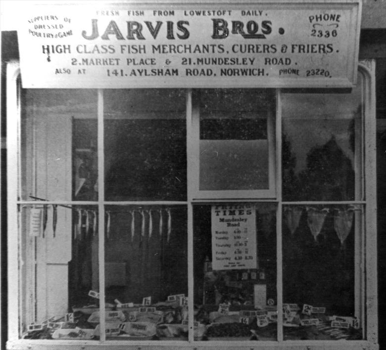 Photograph. Jarvis Bros, Fishmongers, 2 Market Place, North Walsham. After C.Mace, photographer (1947) (North Walsham Archive).