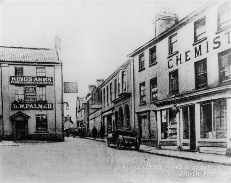 Photograph. Kings Arms St., North Walsham. Oliver's Chemist on the right later became Oliver & Griston, Chemist & Optician after W.W.I. (North Walsham Archive).
