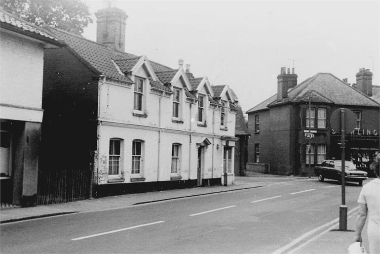 Photograph. Kings Arms Street, North Walsham in the late 1960s (North Walsham Archive).