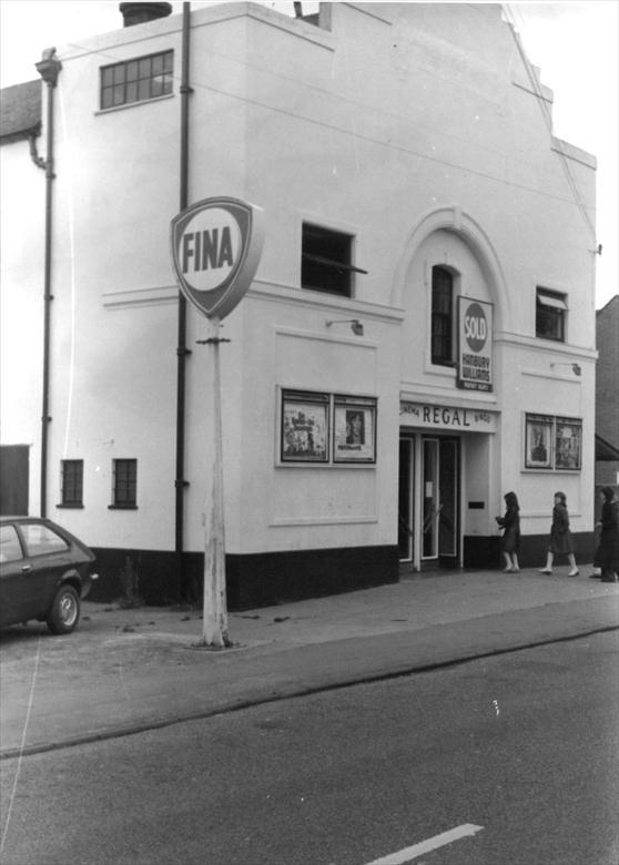 "Photograph. Last days of the Regal Cinema, New Road, North Walsham. Whilst still open, there is a ""Sold"" sign above the door. (North Walsham Archive)."