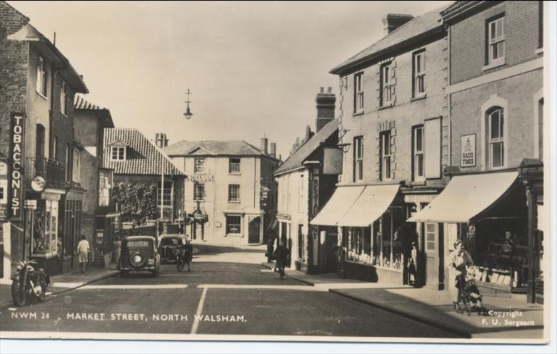 Photograph. Market Street North Walsham, about 1950. (North Walsham Archive).