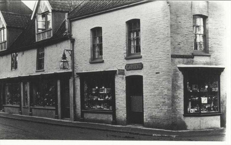 Photograph. Miss Long's shop, corner Church Street and Market Place. (North Walsham Archive).