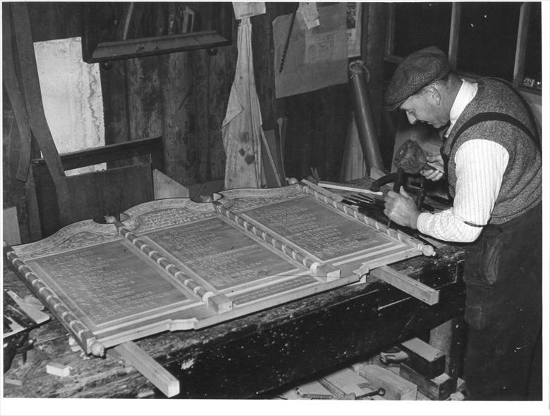 Photograph. Mr L.W.Roper, Craftsman, at work on the World War Two Memorial (North Walsham Archive).