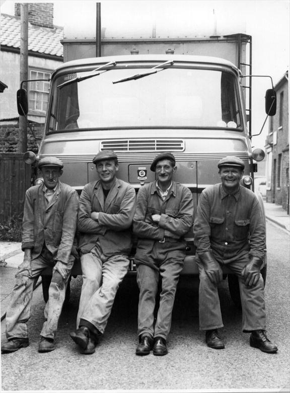 Photograph. The North Walsham Dust Cart Crew posing at the top of Vicarage Street (North Walsham Archive).