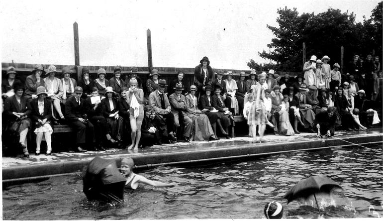 Photograph. North Walsham Girls' High school 1931 swimming sports at the Paston Grammar School's swimming pool (North Walsham Archive).