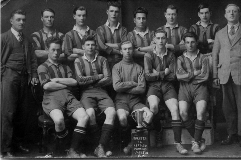 Photograph. North Walsham Hornets football team, 1929-30 season, winners of the Melton Challenge Cup. Alma Hicks top left. (North Walsham Archive).