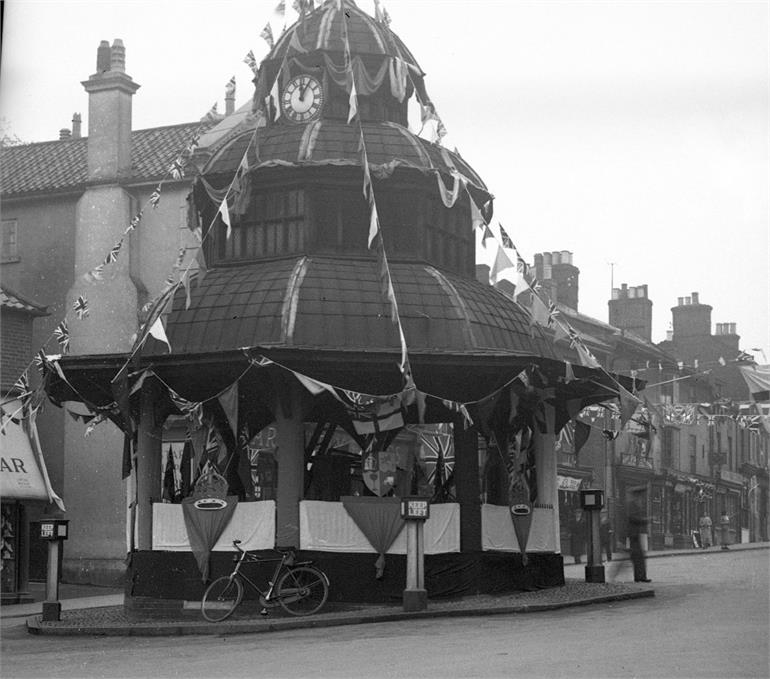 Photograph. North Walsham Market Cross decorated for the Coronation of King George VI - 12th May 1937. (North Walsham Archive).