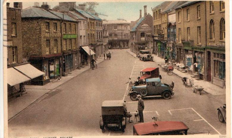 Photograph. North Walsham Market Place. Number Plate in foreground was registered in London in 1925. (North Walsham Archive).