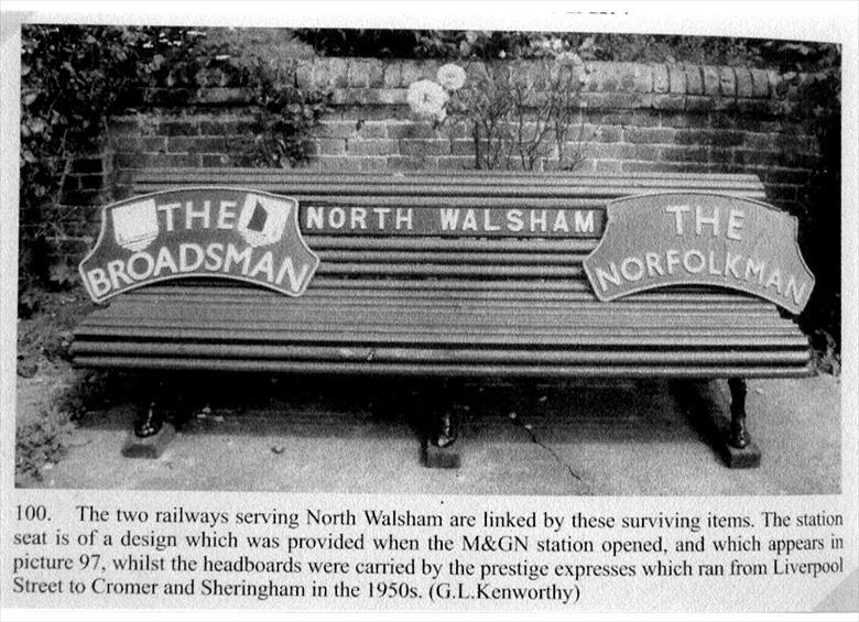 Photograph. North Walsham Railway memorabilia. Original bench of M&GN and express headboards. (North Walsham Archive).