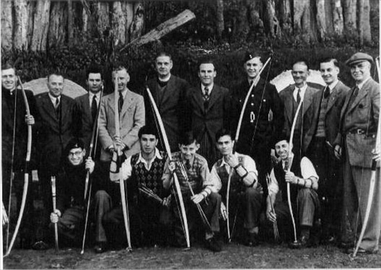 Photograph. North Walsham Rifle & Archery Club at their range on Happisburgh Road, North Walsham. Secretary, Mr J.R.Brooks on the far right (North Walsham Archive).