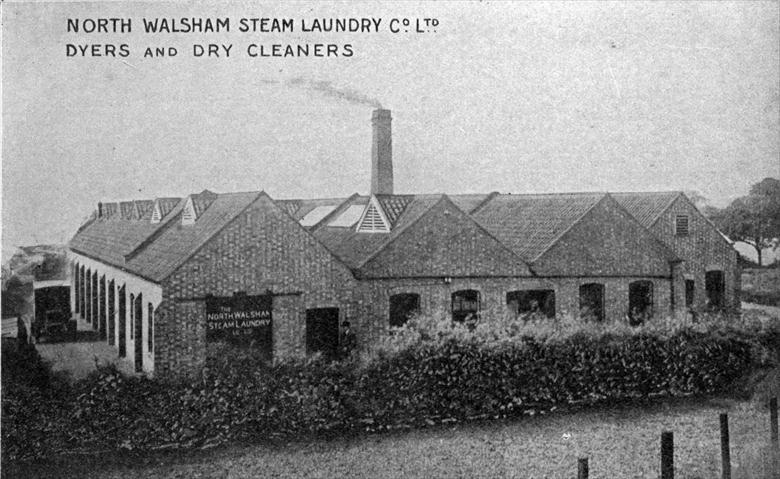 Photograph. North Walsham Steam Laundry Co. Ltd. The Straker Squire van beside the building had its bodywork built by Frank Mann, Vicarage Street. (North Walsham Archive).