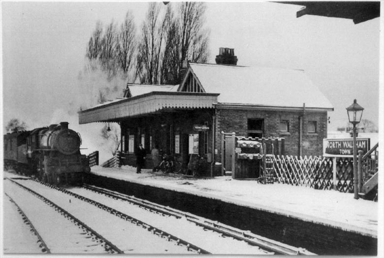 "Photograph. North Walsham ""Town"" Station. The train approaching, engine No. 43158, was bound for the Yarmouth ""Beach"" Station (North Walsham Archive)."