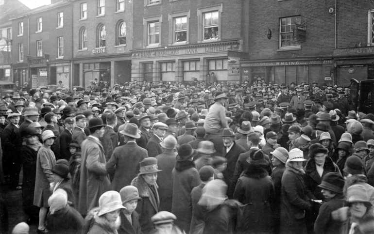 Photograph. Crowd for North Walsham's first motor ambulance in Market Place (North Walsham Archive).