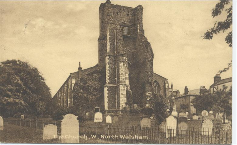 Photograph. Parish Church yard, North Walsham, note tombstones and railings still in situ. (North Walsham Archive).