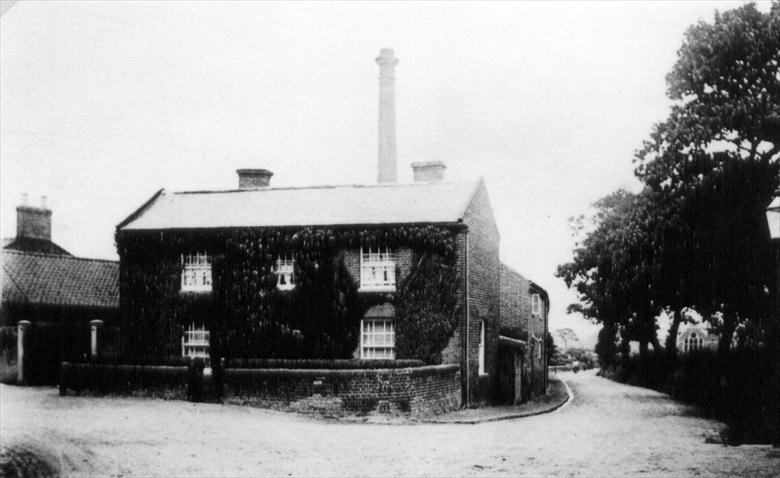 Photograph. Park Hall Cottage, New Road, North Walsham. Looking north down Pound Road. (North Walsham Archive).