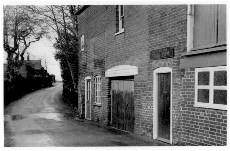 Photograph. Park Lane, from Kings Arms Street. The buildings have been replaced by terraced housing and the road widened towards the school and surgeries. (North Walsham Archive).