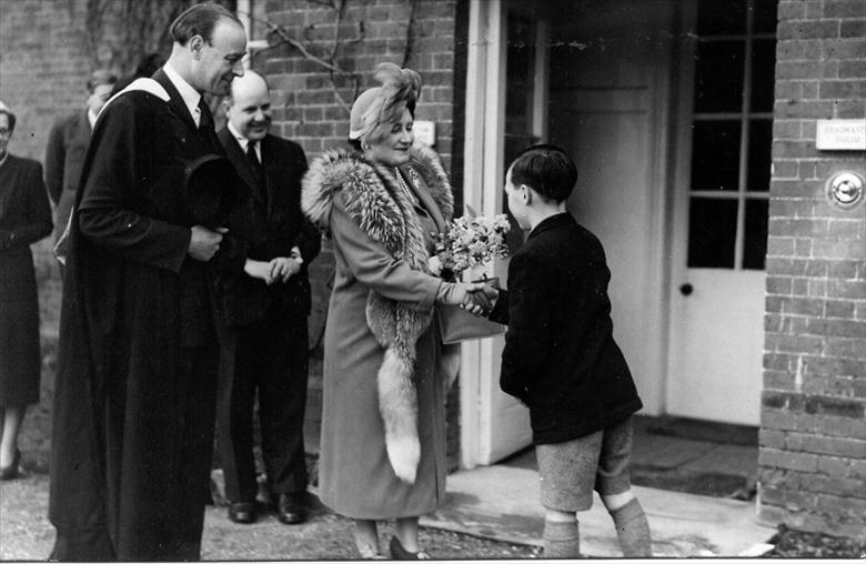 Photograph. Presentation of boquet to Queen Elizabeth on her visit to Paston Grammar School (North Walsham Archive).