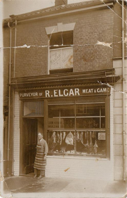 Photograph. R Elgar butcher in North Walsham Market Place (North Walsham Archive).