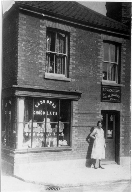 Photograph. Rackstraw's Oil & Hardware, 15 Mundesley Road, North Walsham. Mrs Violet Wesby lived in the flat above, with husband Bertie, until 1939 (North Walsham Archive).