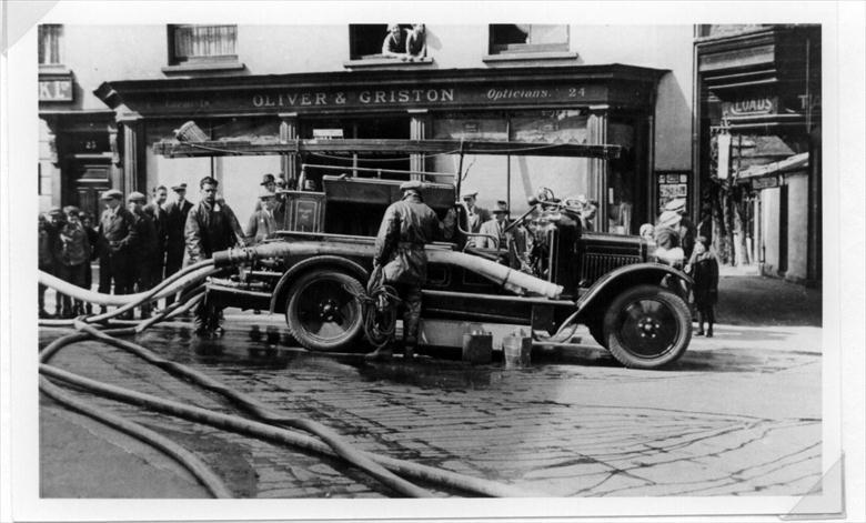 Photograph. Second Motorised Fire Engine in Market Place, North Walsham - Butchery fire (North Walsham Archive).