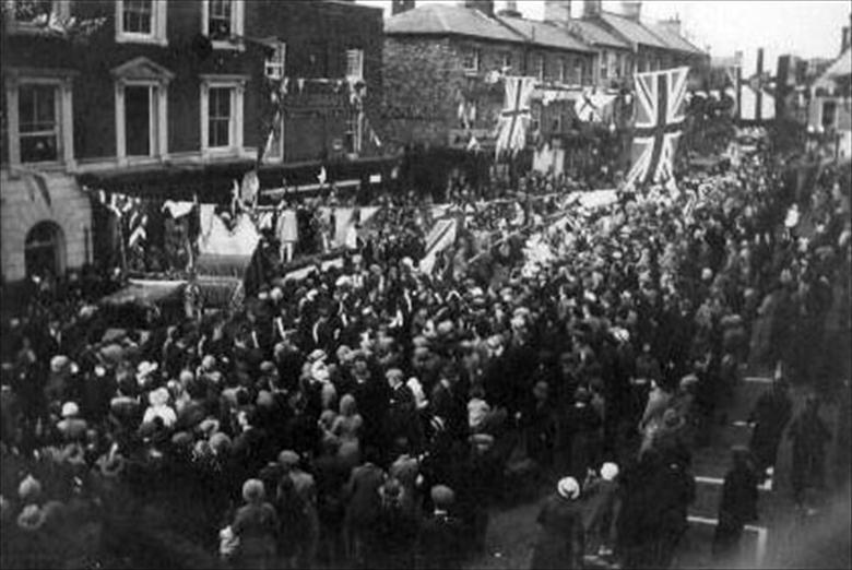 Photograph. Silver Jubillee celebrations in the North Walsham Market Place. (North Walsham Archive).