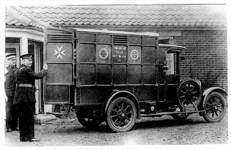 Photograph. St John's First motorised Ambulance - outside the North Walsham Cottage Hospital. (North Walsham Archive).