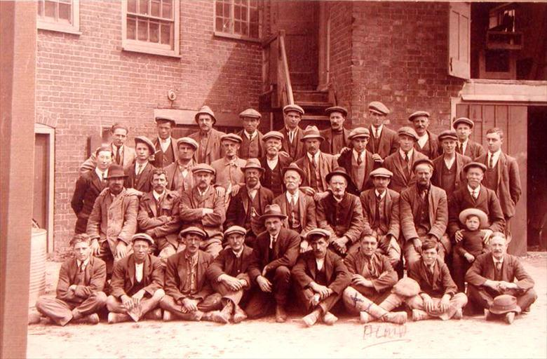 Photograph. Staff of William A. Hicks, builders & contractors, Bacton Road, North Walsham (North Walsham Archive).