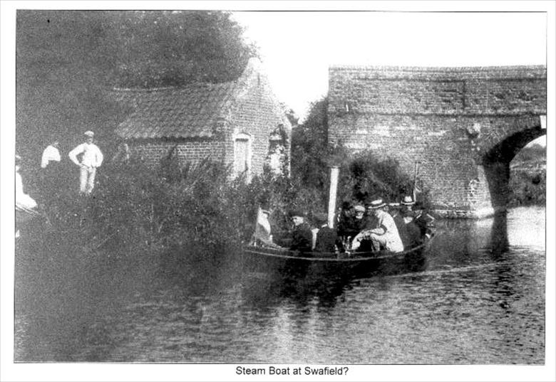Photograph. Steam Boat at Swafield Bridge on the North Walsham-Dilham Canal.. Ling collection (North Walsham Archive).