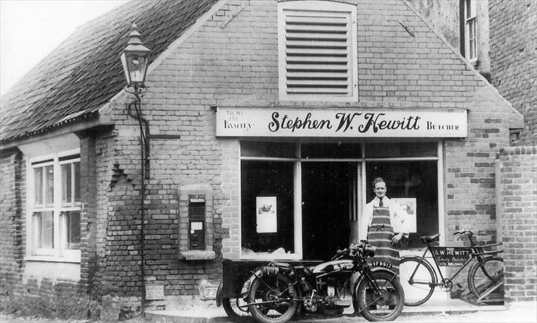 Photograph. Stephen Hewitt, Butcher, outside his new shop, Mundesley Road, North Walsham. (North Walsham Archive).