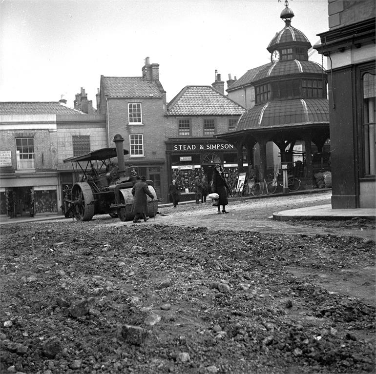 Photograph. Surfacing the Market Place, North Walsham. (North Walsham Archive).