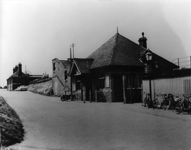 "Photograph. The Ticket Office at the North Walsham "" Main"" Station. Access to the Cromer-bound platform was via a tunnel under the railway. (North Walsham Archive)."
