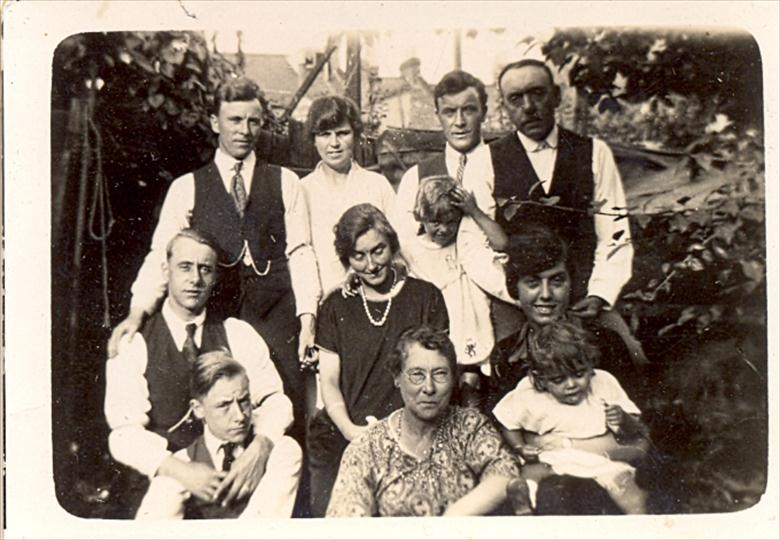 Photograph. Top: Joseph Shaw,Aunt Queenie,Uncle Earnest,Grampa Shaw. Middle: Uncle Bert,Auntie Elsie, Eileen Shaw. Bottom: Uncle Fred, Grandma Shaw, Elsie Shaw. (North Walsham Archive).