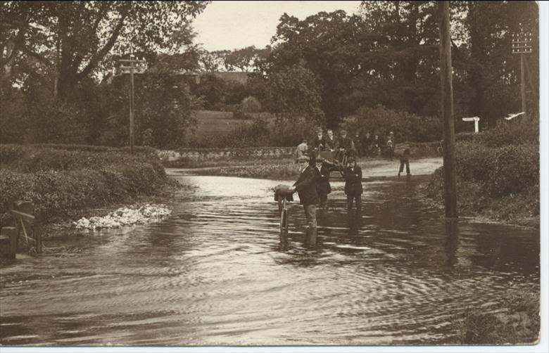 Photograph. View of 1912 flood at Royston Bridge, North Walsham (North Walsham Archive).