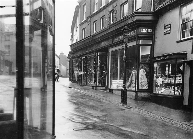 Photograph. A view up Kings Arms Street from Market Street in North Walsham. (North Walsham Archive).