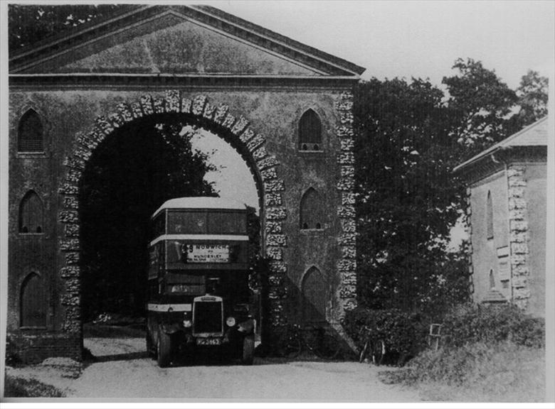 Photograph. Westwick arch with Leyland TD1 motorbus (North Walsham Archive).