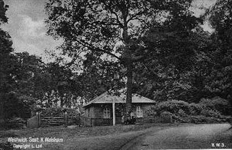 Photograph. Westwick Seat on Norwich Road in Westwick Woods at junction to Swanton Abbot. (North Walsham Archive).